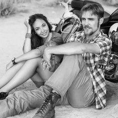 fashion couple sitting on a motorcycle