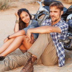 Wall Mural - fashion couple sitting on a motorcycle
