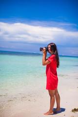 Profile of young beautiful woman photographed beautiful seascape