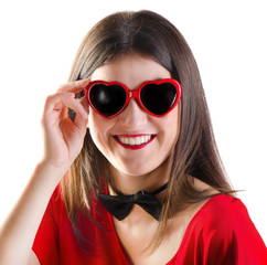 Smiling girl with heart glasses