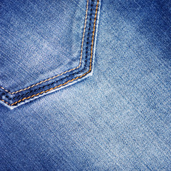 Texture of blue jeans. Close-up