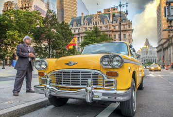 Vintage scene in New York. Old yellow cab in city streets