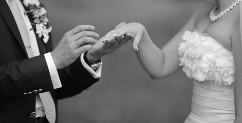 Hands of wedding couple.