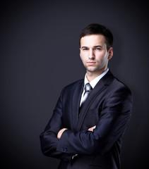 businessman standing on dark gradient background