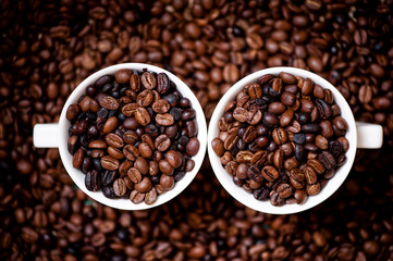 Detail of white cups of coffee filled with coffee beans