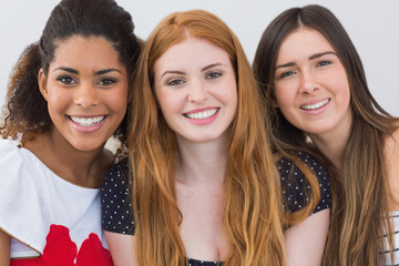 Close up portrait of cheerful female friends