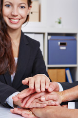 Business people stacking hands for cooperation