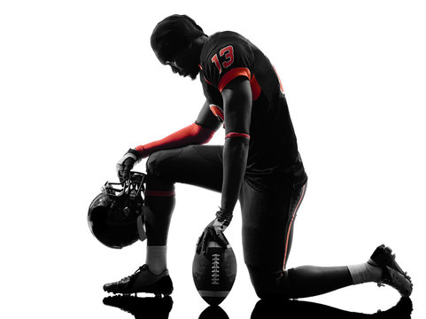 american football player kneeling silhouette