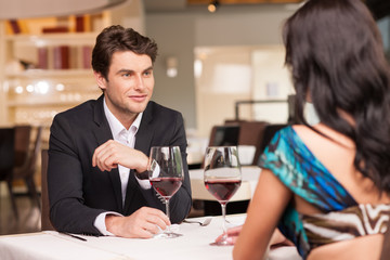 Seducing  handsome man looking at beautiful woman