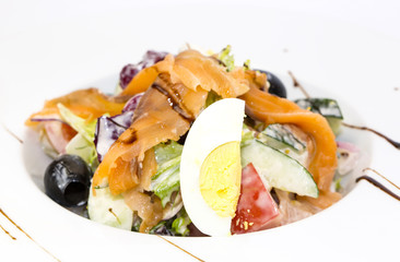 seafood salad vegetables and eggs on a white background