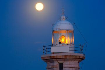 Foto op Aluminium Volle maan Ciutadella Menorca Punta Nati lighthouse moon shine