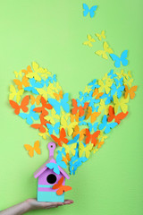 Paper butterflies fly out of nesting box