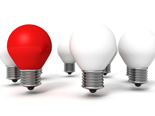 Red light bulb lamp leadership concept out from crowd