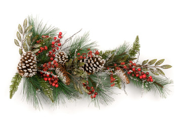Christmas garland  with red berries and pine cones on white