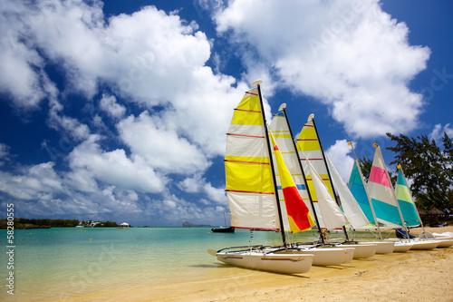 Wall mural Beach with sailboats in Mauritius Island