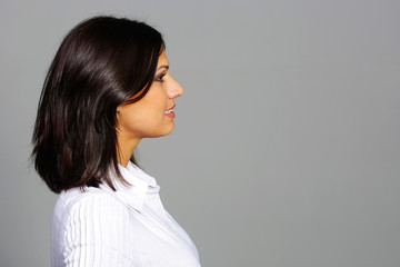 Side photo of a beautiful brunette looking at copyspace
