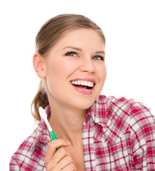 Happy woman with toothy smile showing tooth brush