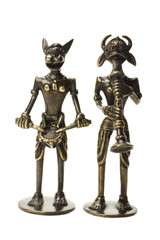 Close-up of two tribal figurines with traditional musical instrument
