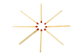 Close-up of matchsticks in a circle