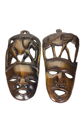 Close-up of two wooden masks