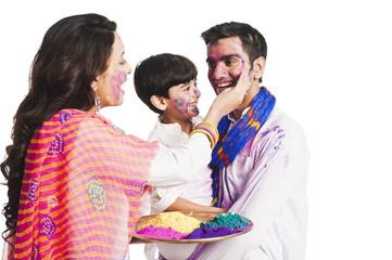 Family celebrating Holi festival