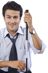 Portrait of a businessman smiling with holding a golf club