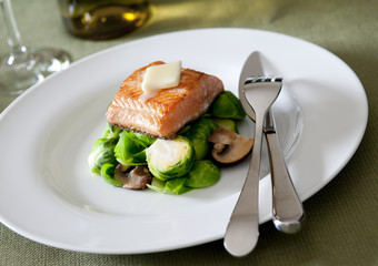 Closeup of seared salmon with vegetables.