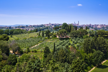 Garden with Castello Delle Quattro Torra hotel in the background, Siena, Siena Province, Tuscany, Italy