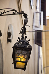 Lantern hanging on the wall of a house, Florence, Tuscany, Italy