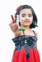 Portrait of a girl showing tricolor on her fingers