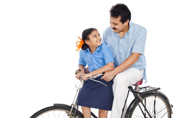 Man with his daughter on a bicycle