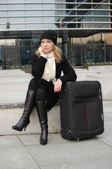 young woman with a travel suitcase
