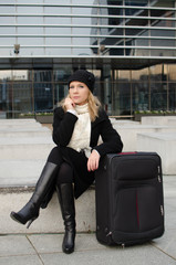 young woman with baggage