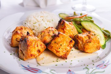 Zesty Chicken Shish Kebabs served on a Lavash Bread with rice Pi