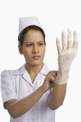 Female nurse wearing a surgical glove