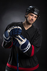 Attractive young hockey player posing on camera