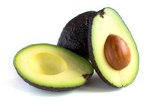 A fresh avocado cut in half