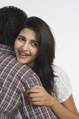 Woman embracing a man