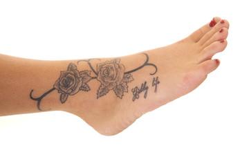 Tattoo close rose foot