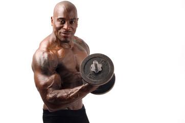 Black bodybuilder training with heavy dumbbell.