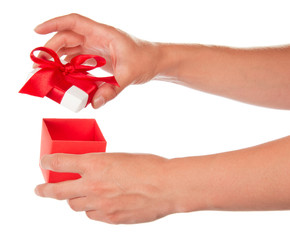 The female hand opens box with gift