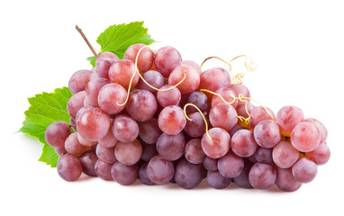 Fototapete - Fresh red grapes with leaves. Isolated on white