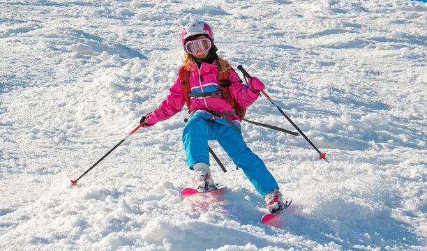 Child skiing in sharp cornering