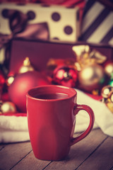 Cup of coffee and gifts