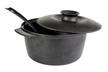 Old cast iron cauldron with scoop , isolated