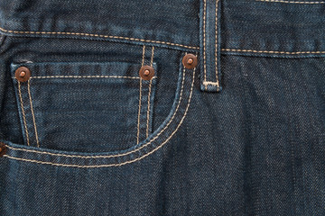 pocket and waistband of denim blue jeans as a background