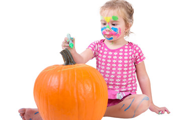 Toddler Girl Painting the Pumpkin for Halloween