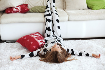 Child in cow print pajamas