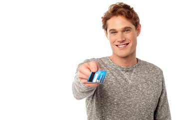 Guy showing his credit card