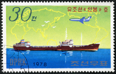 stamp printed by DPR KOREA  shows jet plane with ship